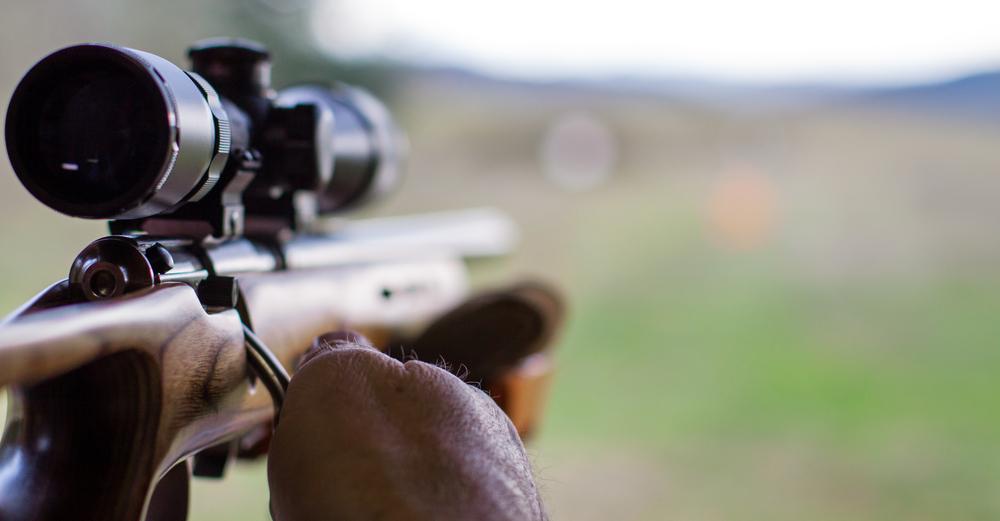 taking aim with a gun